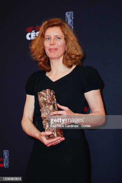 Claire Mathon poses with the Best Cinematography award for the movie 'Portrait de la Jeune Fille en Feu' during the Cesar Film Awards 2020 Ceremony...