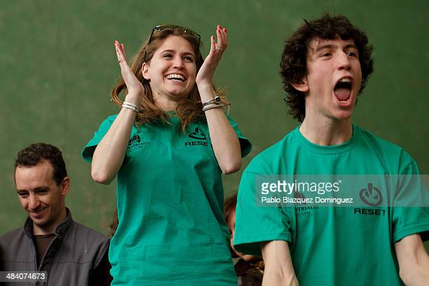 Claire Merlin and Javier Anton react as their friend Carlos Hucha wins a sumo robots combat during the Cybertech robotics competition at the the...