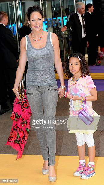 Claire Merry former wife of Thierry Henry and their daughter Tea at the UK film premiere of 'Hannah Montana The Movie' held at the Odeon Leicester...