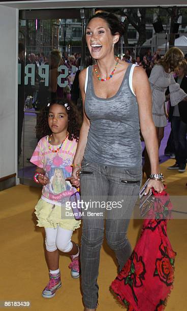 Claire Merry with her daughter Tea arrive at the UK premiere of 'Hannah Montana The Movie' at the Odeon Leicester Square on April 23 2009 in London...