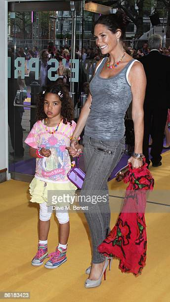 Claire Merry with her goddaughter Maisybelle arrive at the UK premiere of 'Hannah Montana The Movie' at the Odeon Leicester Square on April 23 2009...