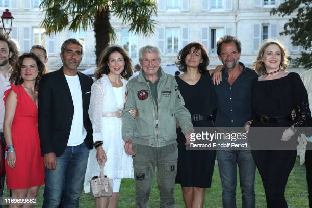 Claire Morin Ary Abittan Elsa Zylbertstein Director Claude Lelouch Marianne Denicourt Stephane de Groodt and Agnes Soral attend the Photocall of the...