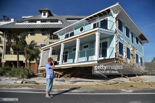 TOPSHOT Claire mourns as she sees the damage caused by Hurricane Michael in Mexico Beach Florida on October 12 2018 In devastated Mexico Beach where...