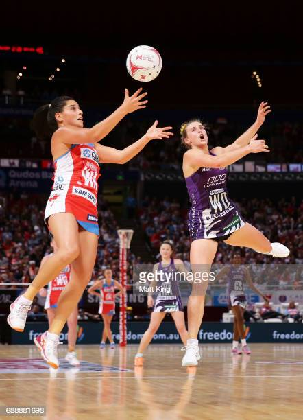 Claire O'Brien of the Swifts competes with Gabi Simpson of the Firebirds during the round 14 Super Netball match between the Swifts and the Firebirds...
