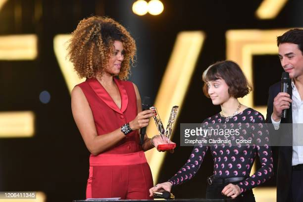 Claire Pommet aka Pomme celebrates after receiving the best newcomer album award next to Sophie Ducasse during the 35th 'Les Victoires De La Musique'...