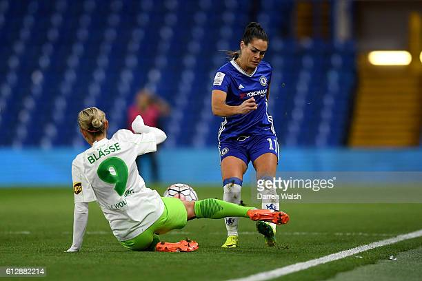 Claire Rafferty of Chelsea Ladies and Anna Blasse of Wolfsburg compete during a UEFA Champions League match between Chelsea Ladies and Wolfsburg at...