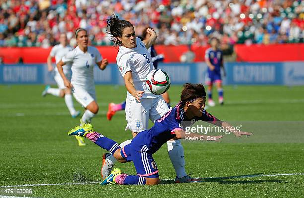 Claire Rafferty of England fouls Saori Ariyoshi of Japan to concede a penalty during the FIFA Women's World Cup Semi Final match between Japan and...