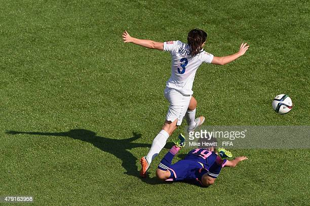 Claire Rafferty of England gives away a penalty by fouling Saori Ariyoshi of Japan during the FIFA Women's World Cup 2015 Semi Final match between...