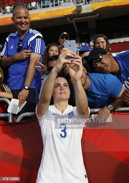 Claire Rafferty of England poses for a selfie with supporters after the FIFA Women's World Cup 2015 round of 16 match between Norway and England at...
