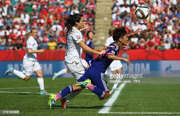 Claire Rafferty of England tackles Saori Ariyoshi of Japan to give away a penalty during the FIFA Women's World Cup 2015 Semi Final match between...