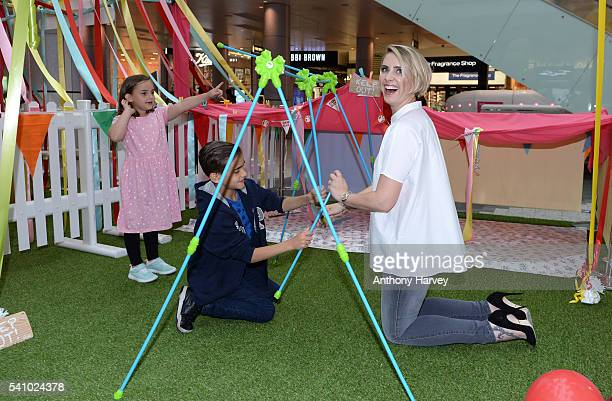 Claire Richards supports Save the Children's Den Day with her family Daisy Hill and Charlie Hill at Westfield London on June 18 2016 in London England