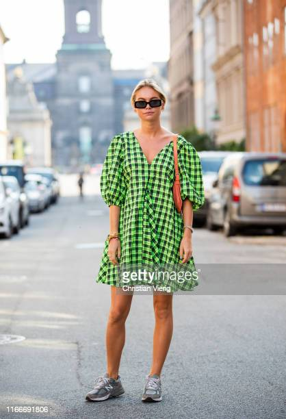 Claire Rose Cliteur is seen wearing green plaid dress outside Helmstedt during Copenhagen Fashion Week Spring/Summer 2020 on August 07, 2019 in...