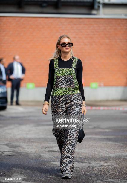 Claire Rose Cliteur is seen wearing overall with animal print outside By Malene Birger during Copenhagen Fashion Week Spring/Summer 2020 on August...