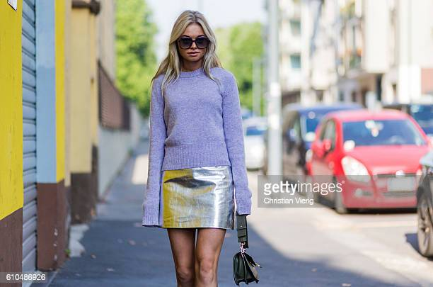 Claire Rose Cliteur wearing a pink sweater and metallic mini skirt and JW Anderson bag outside Marni during Milan Fashion Week Spring/Summer 2017 on...