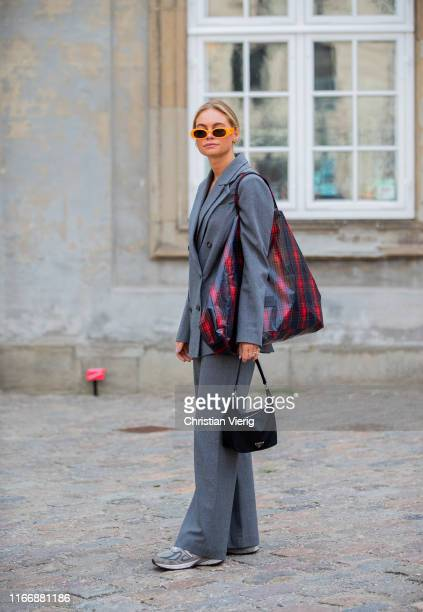 Claire Rose Cliteur wearing grey blazer and pants outside Designers Remix during Copenhagen Fashion Week Spring/Summer 2020 on August 08, 2019 in...