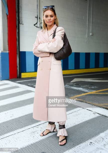 Claire Rose is seen wearing a pink coat and sandals at the Rebecca Minkoff show during New York Fashion Week on February 08 2020 in New York City