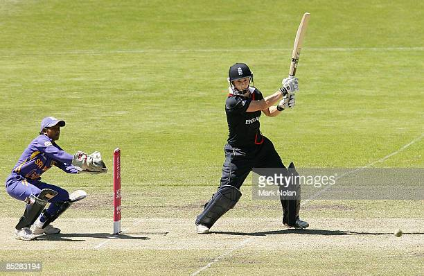 Claire Taylor of England brings up her century during the ICC Women's World Cup 2009 round one group stage match between England and Sri Lanka at...