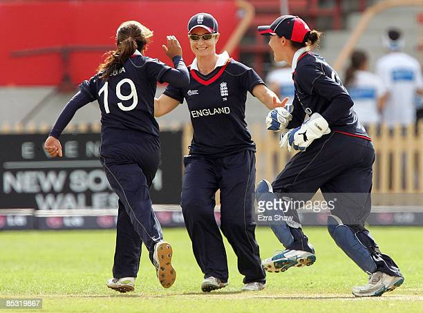 Claire Taylor of England congratulates Isa Guha and Sarah Taylor after Anjum Chopra of India given out during the ICC Women's World Cup 2009 round...