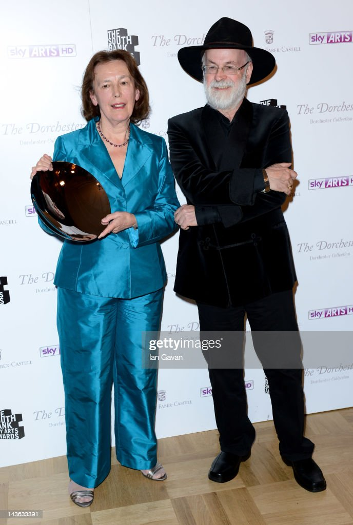 Claire Tomalin, winner of the Literature category and presenter Terry Pratchett pose for a photograph during the South Bank Sky Arts Awards at Dorchester Hotel on May 1, 2012 in London, England.