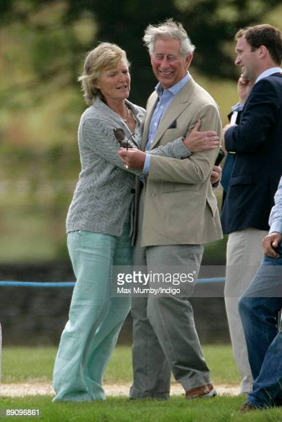 Claire Tomlinson hugs HRH Prince Charles Prince of Wales as they attend The Chakravarty Cup Polo Match 2009 at Beaufort Polo Club on July 18 2009 in...