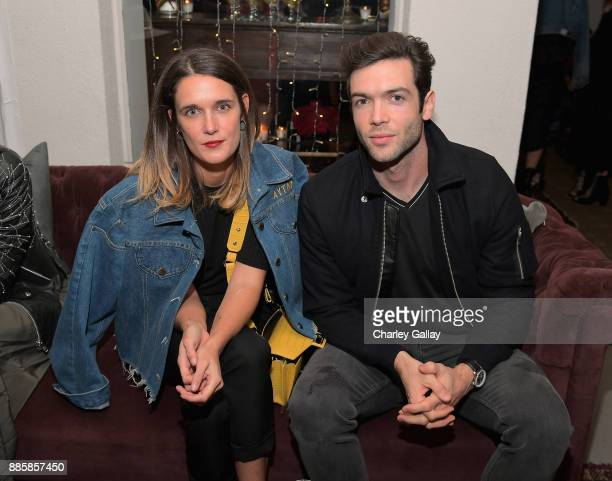 Claire Touzard and Ethan Peck at The Kooples and Emily Ratajkowski LA Cocktail Event at Chateau Marmont on December 4 2017 in Los Angeles California
