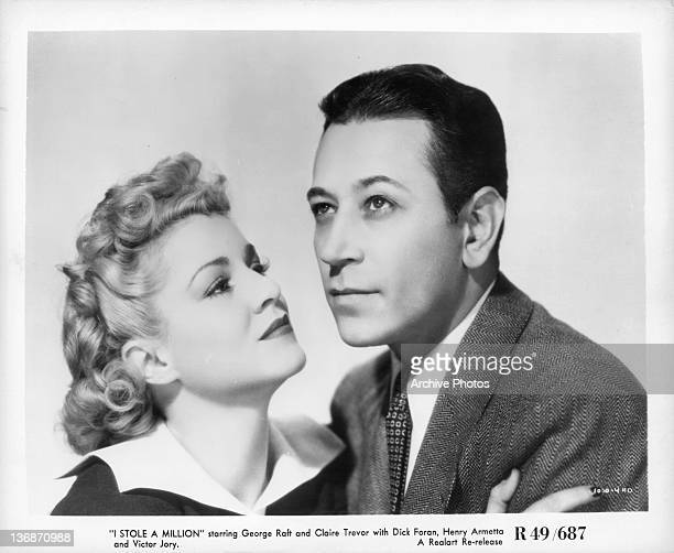 Claire Trevor looking up at actor George Raft in a scene from the film 'I Stole A Million' 1939