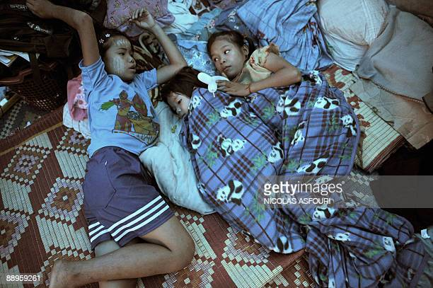 STORY THAILANDMYANMARRIGHTSUNRESTETHNICREFUGEES BY Claire Truscot This photo taken on June 18 2009 shows two Karen refugee orphans taking care of a...