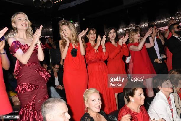 Claire Verneil, Candice de Saint Pern, Stephanie de Muru, Sandrine Sarroche and Karine De Menonville attend the 'Red Defile' Auction Fashion Show...