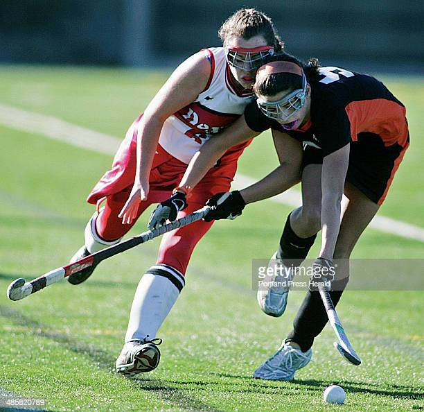 Claire Wyman of Dexter left and Katherine Millett of NYA race for the ball during the Class C field hockey championships at Hampden Academy Saturday...