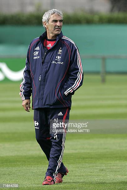 France's coach Raymond Domenech walks during a training session 14 August 2006 in Clairfontaine two days before the friendly match France vs Bosnia...