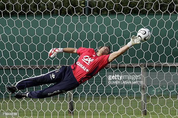 French goalkeeper Gregory Coupet stops a ball during a training session 14 August 2006 in Clairfontaine two days before the friendly match France vs...