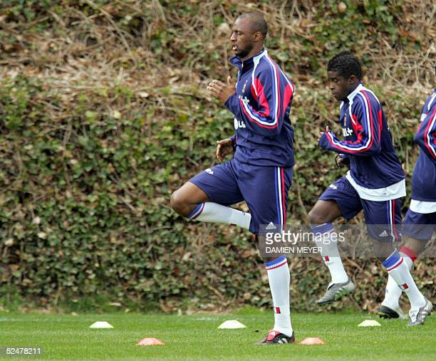 French soccer national team captain midfielder Patrick Vieira and Rio Antonio Mavuba warm up during a training session 25 March 2005 in...