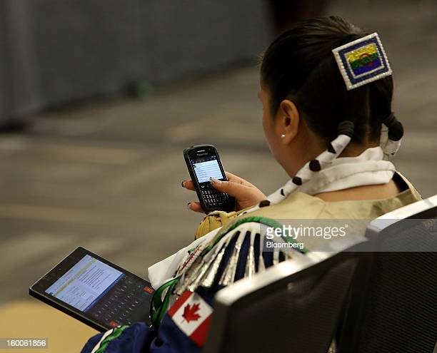 Clairissa Kelly of the Peguis First Nations checks her mobile devices during the Idle No More Youth Forum in Ottawa Ontario Canada on Friday Jan 25...
