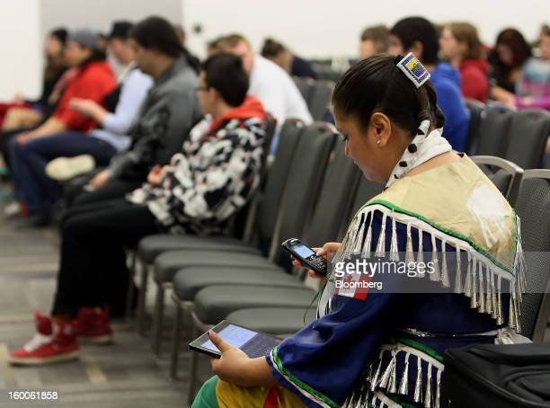 Clairissa Kelly of the Peguis First Nations right checks her mobile devices during the Idle No More Youth Forum in Ottawa Ontario Canada on Friday...