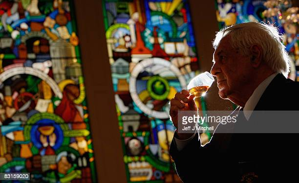 Claive Vidiz from Brazil toasts his record breaking collection of Scottish Whiskies on October 7 2008 in Edinburgh Scotland A specially designed...