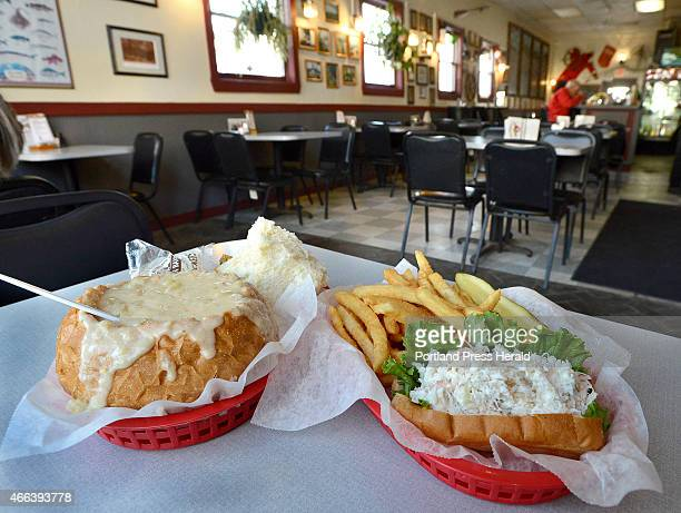 Clam chowder in a bread bowl and a crab meat roll with fries served at Gilbert's Chowder House in Portland