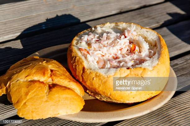 clam chowder served in a bread bowl - pismo beach stock pictures, royalty-free photos & images