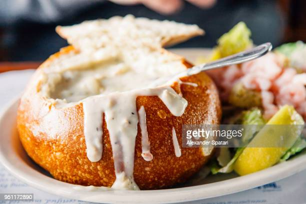 clam chowder served in a bread bowl - north beach san francisco stock pictures, royalty-free photos & images
