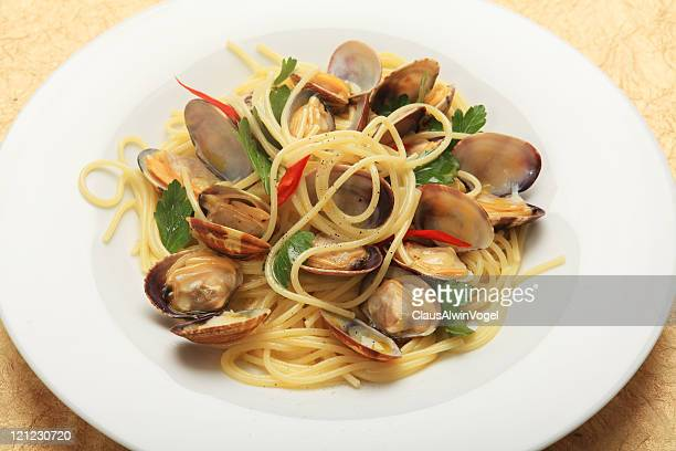 pasta vongole - flat leaf parsley stock photos and pictures