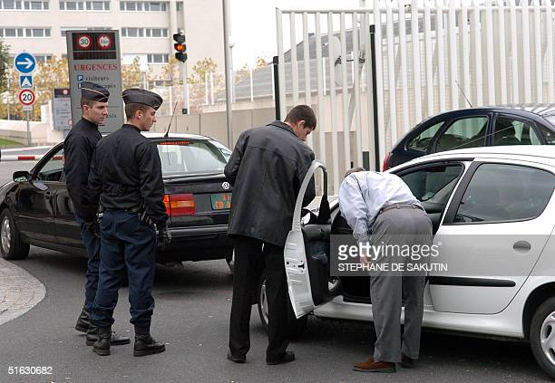Policemen control cars in the entrance of the French military Percy hospital in Clamart south of Paris 31 October 2004 where Palestinian leader...