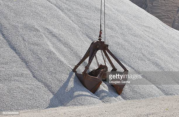 Clamshell Bucket at work in an open pit quarry