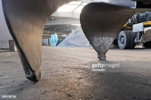 Clamshell of an excavator shovel in a scrap metal recycling plant