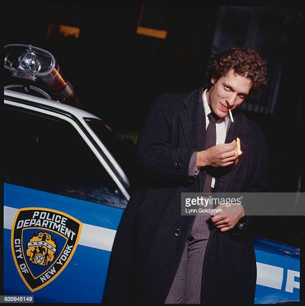 Clancy Brown Lighting Cigarette