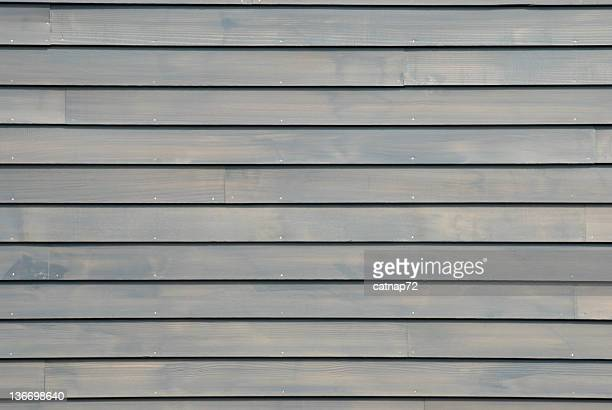 clapboard house siding in new gray, background design element - clapboard stock pictures, royalty-free photos & images