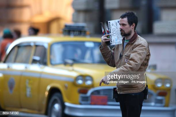 A clapper board is held by a member of the film crew in Glasgow city centre which has been transformed into New York City for the filming of the TV...