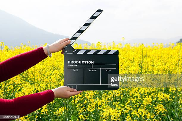 clapper board with hand - clapboard stock pictures, royalty-free photos & images