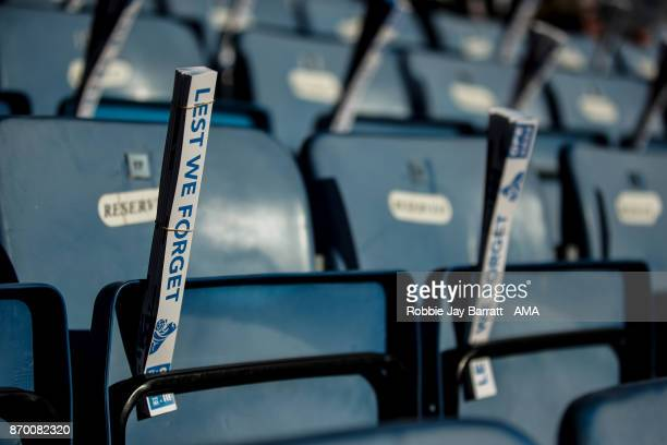 A clapper which reads Lest We Forget is seen prior to the Premier League match between Huddersfield Town and West Bromwich Albion at John Smith's...