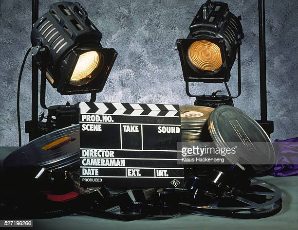 clapperboard, film and two floodlights - film set stock pictures, royalty-free photos & images
