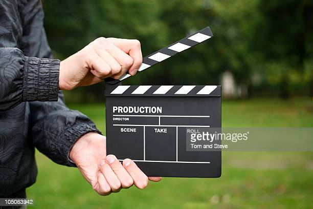 clapper-board, lights, camera, action! - clapboard stock pictures, royalty-free photos & images