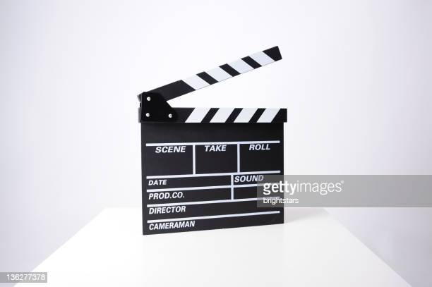 Clapperboard on white table